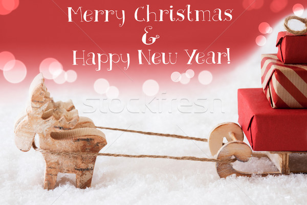 Reindeer With Sled, Red Background, Merry Christmas, Happy New Year Stock photo © Nelosa