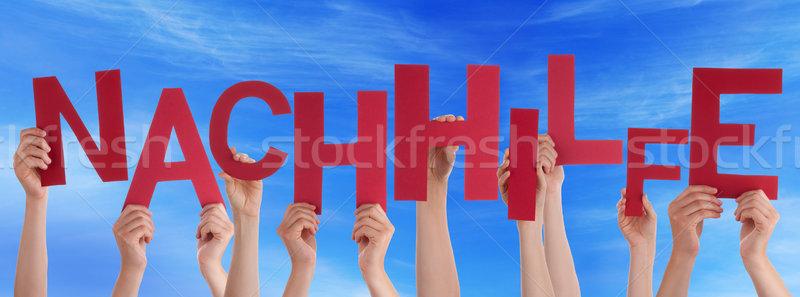 People Hold Word Nachhilfe Means Coaching Blue Sky Stock photo © Nelosa