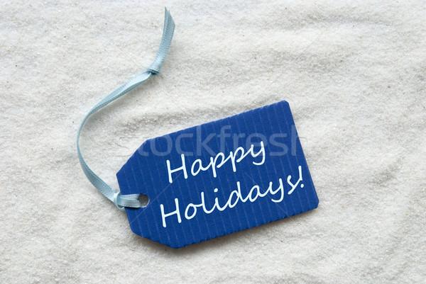 Happy Holidays On Blue Label Sand Background Stock photo © Nelosa