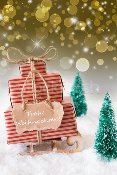 Vertical Sleigh On Golden Background, Frohe Weihnachten Means Merry Christmas Stock photo © Nelosa