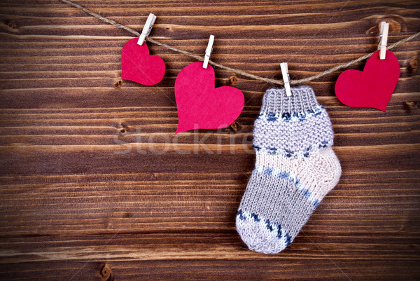 Baby Stockings with Heart on a Line Stock photo © Nelosa