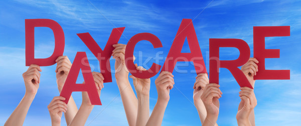 Many People Hands Holding Red Word Daycare Blue Sky Stock photo © Nelosa