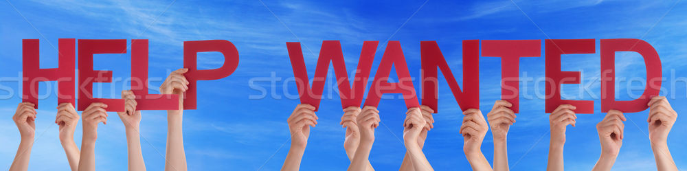 Stock photo: People Hands Holding Red Straight Word Help Wanted Blue Sky