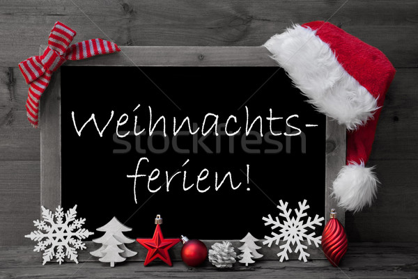 Stock photo: Blackboard Santa Hat Weihnachtsferien Means Christmas Holiday
