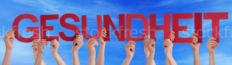People Holding Straight German Word Gesundheit Means Health Blue Stock photo © Nelosa