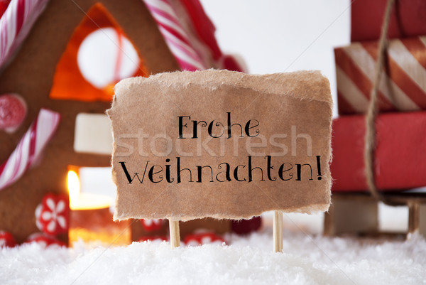Gingerbread House With Sled, Frohe Weihnachten Means Merry Christmas Stock photo © Nelosa