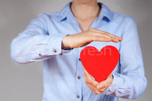 protecting a heart Stock photo © Nelosa