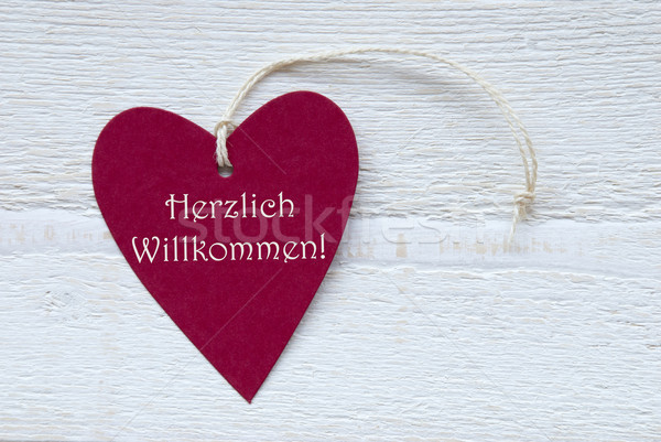 Red Heart Label With German Text Herzlich Willkommen Means Welco Stock photo © Nelosa