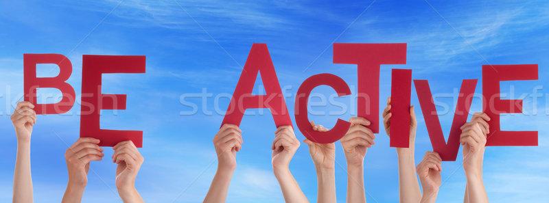 люди рук красный слово активный Сток-фото © Nelosa