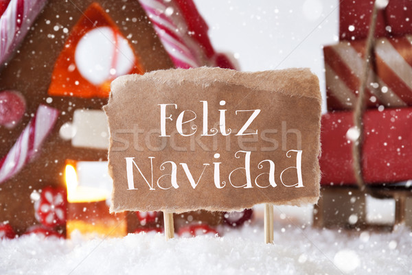 Gingerbread House With Sled, Snowflakes, Feliz Navidad Means Merry Christmas Stock photo © Nelosa