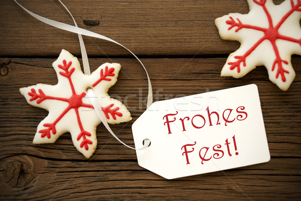 Frohes Fest on a Label with Christmas Star Cookies Stock photo © Nelosa