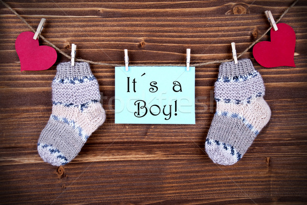 Label with It's a Boy and Baby Stockings on a Line Stock photo © Nelosa