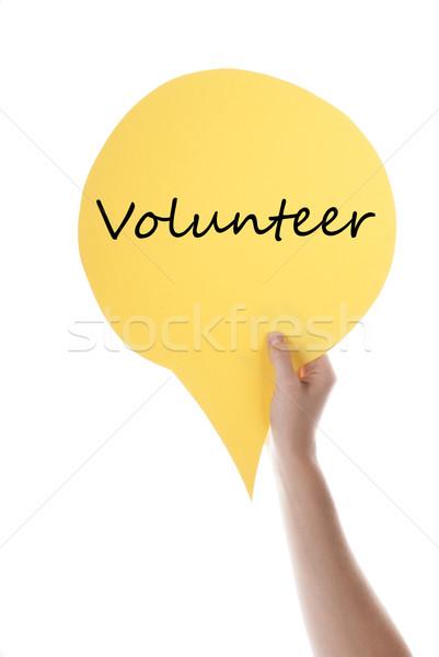 Yellow Speech Balloon With Volunteer Stock photo © Nelosa