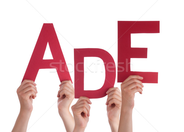 People Holding German Word Ade Means Goodbye  Stock photo © Nelosa