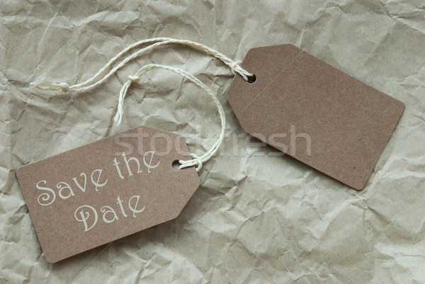 Two Beige Labels With Text Save The Date Paper Background Stock photo © Nelosa