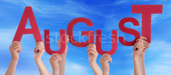 Many People Hands Holding Red Word August Blue Sky Stock photo © Nelosa
