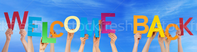 Hands Hold Colorful Word Welcome Back Blue Sky Stock photo © Nelosa