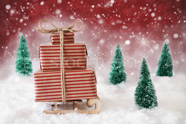 Christmas Sled On Snow With Red Background, Snowflakes And Stars Stock photo © Nelosa