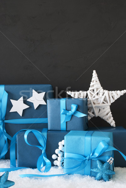 Vertical Blue Christmas Gifts, Black Cement Wall, Snow Stock photo © Nelosa