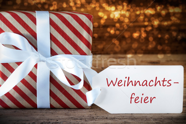 Atmospheric Gift With Label, Weihnachtsfeier Means Christmas Party Stock photo © Nelosa
