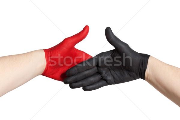 red and black handshake Stock photo © Nelosa