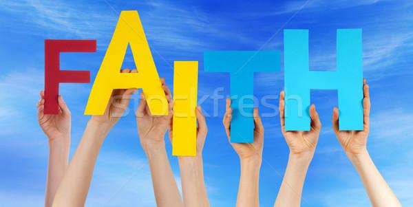 Many People Hands Holding Colorful Word Faith Blue Sky Stock photo © Nelosa