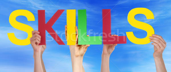 Many People Hands Holding Colorful Straight Word Skills Blue Sky Stock photo © Nelosa