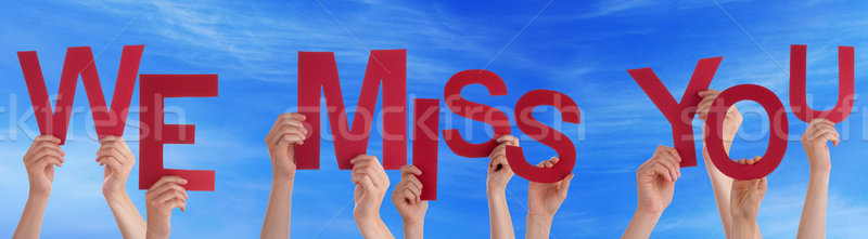 Hands Holding Red Word We Miss You Blue Sky Stock photo © Nelosa