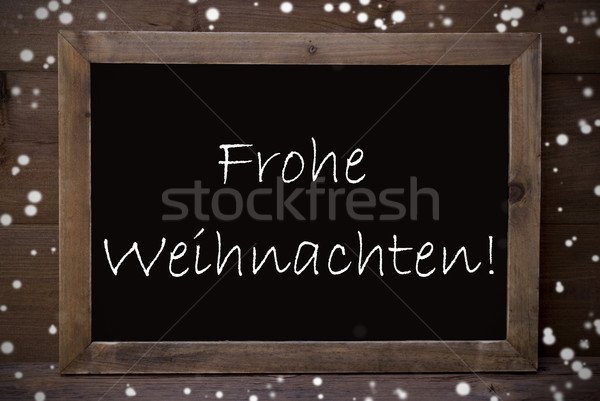 Chalkboard Frohe Weihnachten Means Merry Christmas, Snowflakes Stock photo © Nelosa