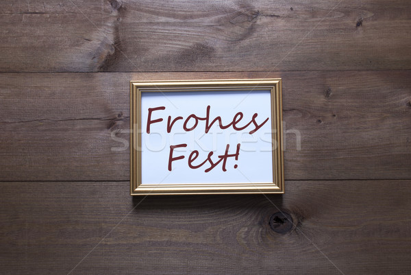 Golden Picture Frame With Frohes Fest Means Merry Christmas Stock photo © Nelosa