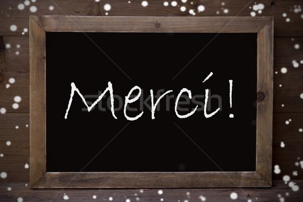 Chalkboard With Merci Means Thank You, Snowflakes Stock photo © Nelosa