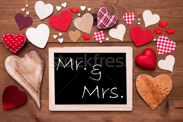 One Chalkbord, Many Red Hearts, Mr And Mrs Stock photo © Nelosa