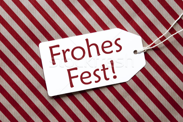 Label On Red Wrapping Paper, Frohes Fest Means Merry Christmas Stock photo © Nelosa