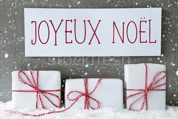 White Gift With Snowflakes, Joyeux Noel Means Merry Christmas Stock photo © Nelosa