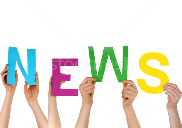 hands holding NEWS Stock photo © Nelosa