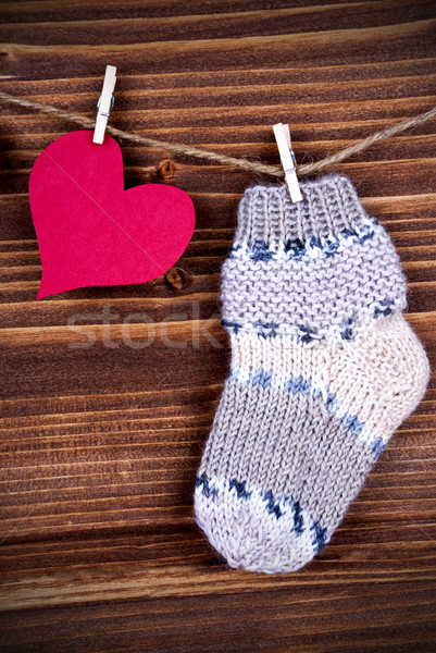 Baby Sock with red Heart on Wood Stock photo © Nelosa