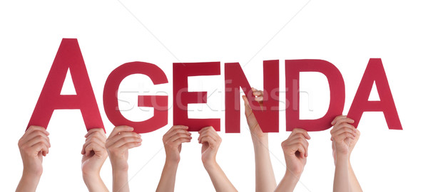 Many People Hands Holding Red Straight Word Agenda Stock photo © Nelosa