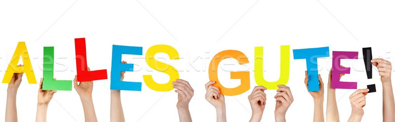 hands holding ALLES GUTE! Stock photo © Nelosa