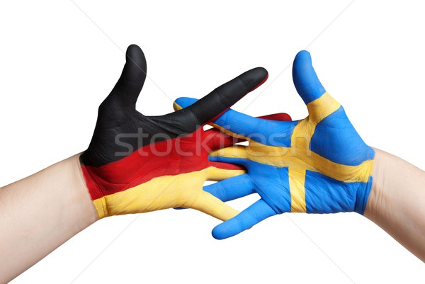 a swedish and a german painted hand Stock photo © Nelosa
