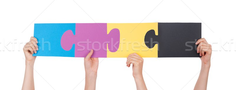 Hands Holding Colorful Pieces of a Puzzle Stock photo © Nelosa