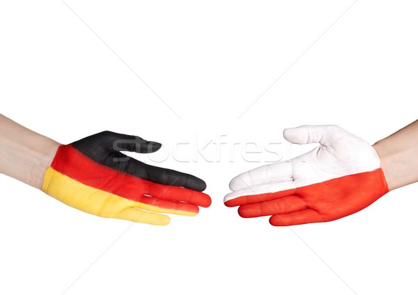 hands with german and polish flag Stock photo © Nelosa