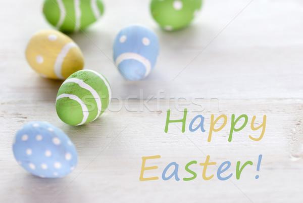 Kék zöld citromsárga húsvéti tojások angol szöveg Stock fotó © Nelosa