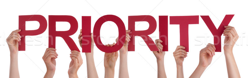 Many People Hands Holding Red Straight Word Priority Stock photo © Nelosa