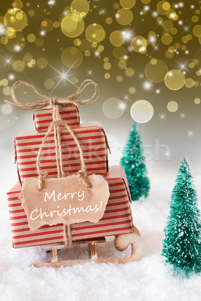 Vertical Sleigh On Golden Background, Text Merry Christmas Stock photo © Nelosa