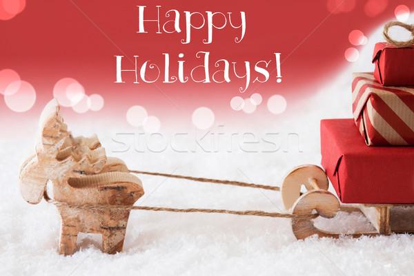 Reindeer With Sled, Red Background, Text Happy Holidays Stock photo © Nelosa