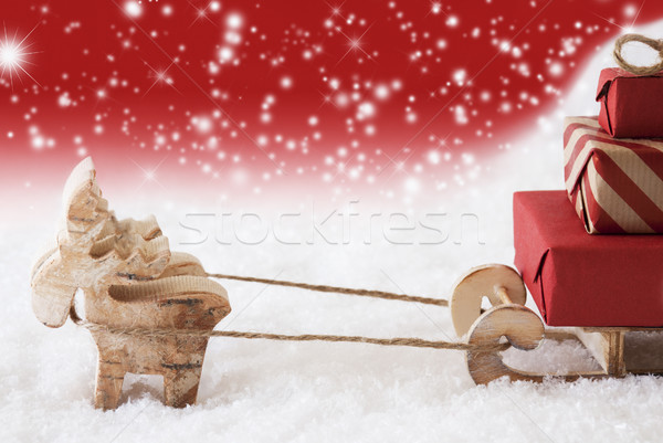 Reindeer With Sled, Red Snowflakes Background, Copy Space Stock photo © Nelosa