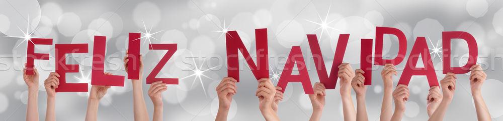 Hands Holding Red Feliz Navidad Stock photo © Nelosa