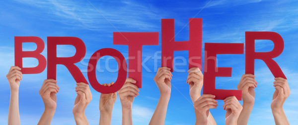 Many People Hands Holding Red Word Brother Blue Sky Stock photo © Nelosa