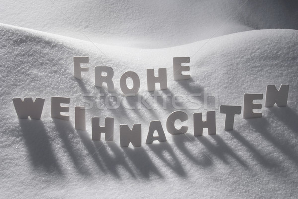 White Word Frohe Weihnachten Means Merry Christmas On Snow Stock photo © Nelosa