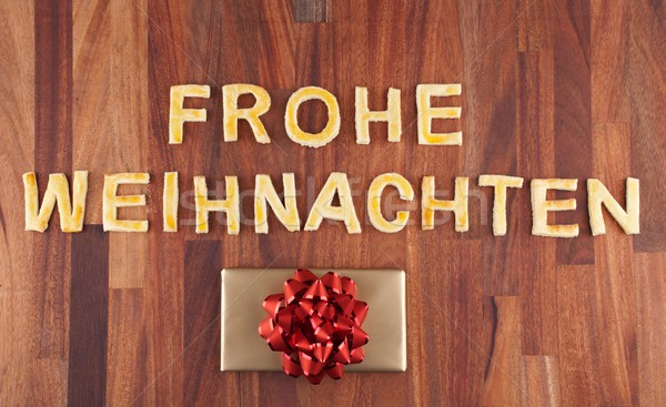 Frohe Weihnachten with cookies and gift Stock photo © Nelosa